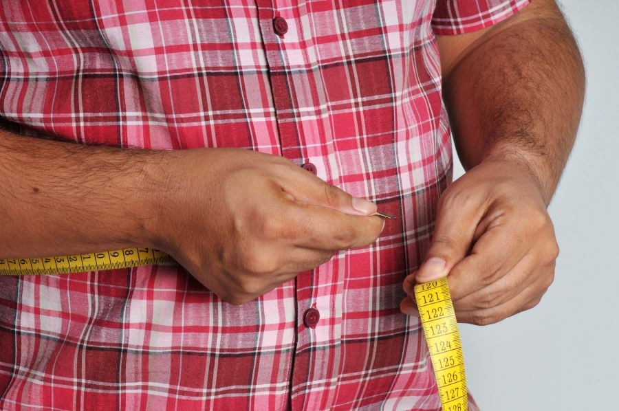 No association was identified between body mass index or waist circumference and the odds of quitting smoking.