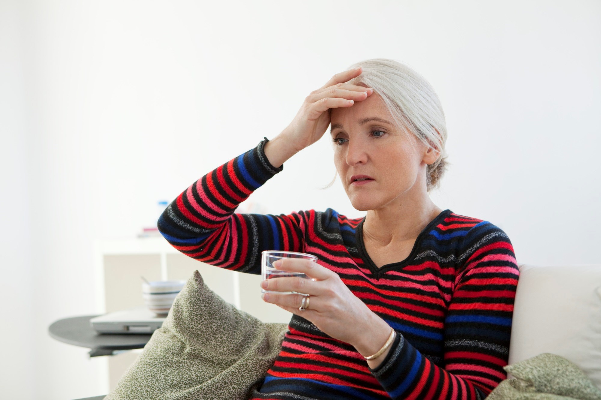 Symptoms more likely in those reporting fair health, history of non-spontaneous menopause